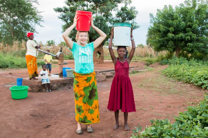 Fetching water - Village in Malawi